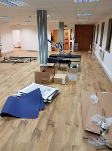 Unpacking boxes and assembling clinic equipment